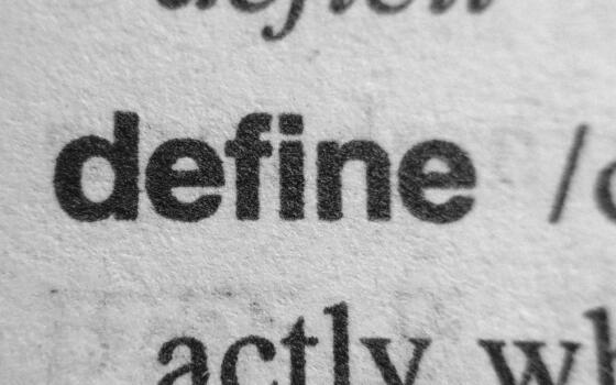 A page with words printed on it. The primary word on the page is 'define'.