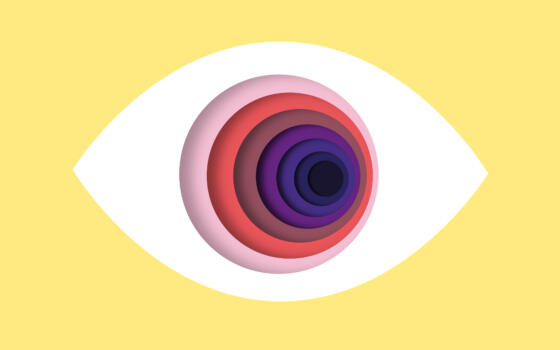 An eye with multi-coloured layers in the pupil.
