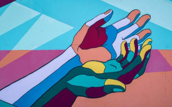 Two cupped, multicolour hands.